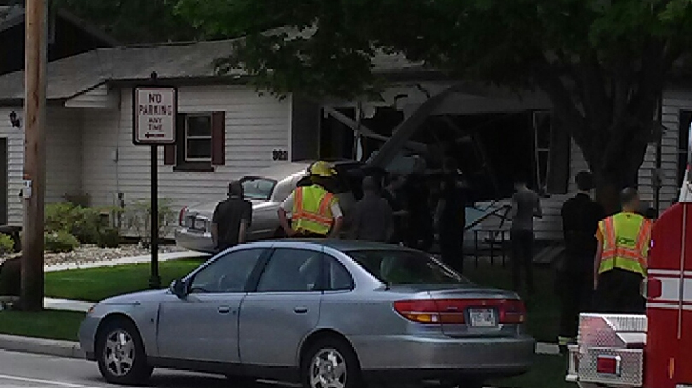 Emergency crews respond after a car crashed into a house on E. Main St. in Little Chute, June 19, 2014. (Submitted photo)