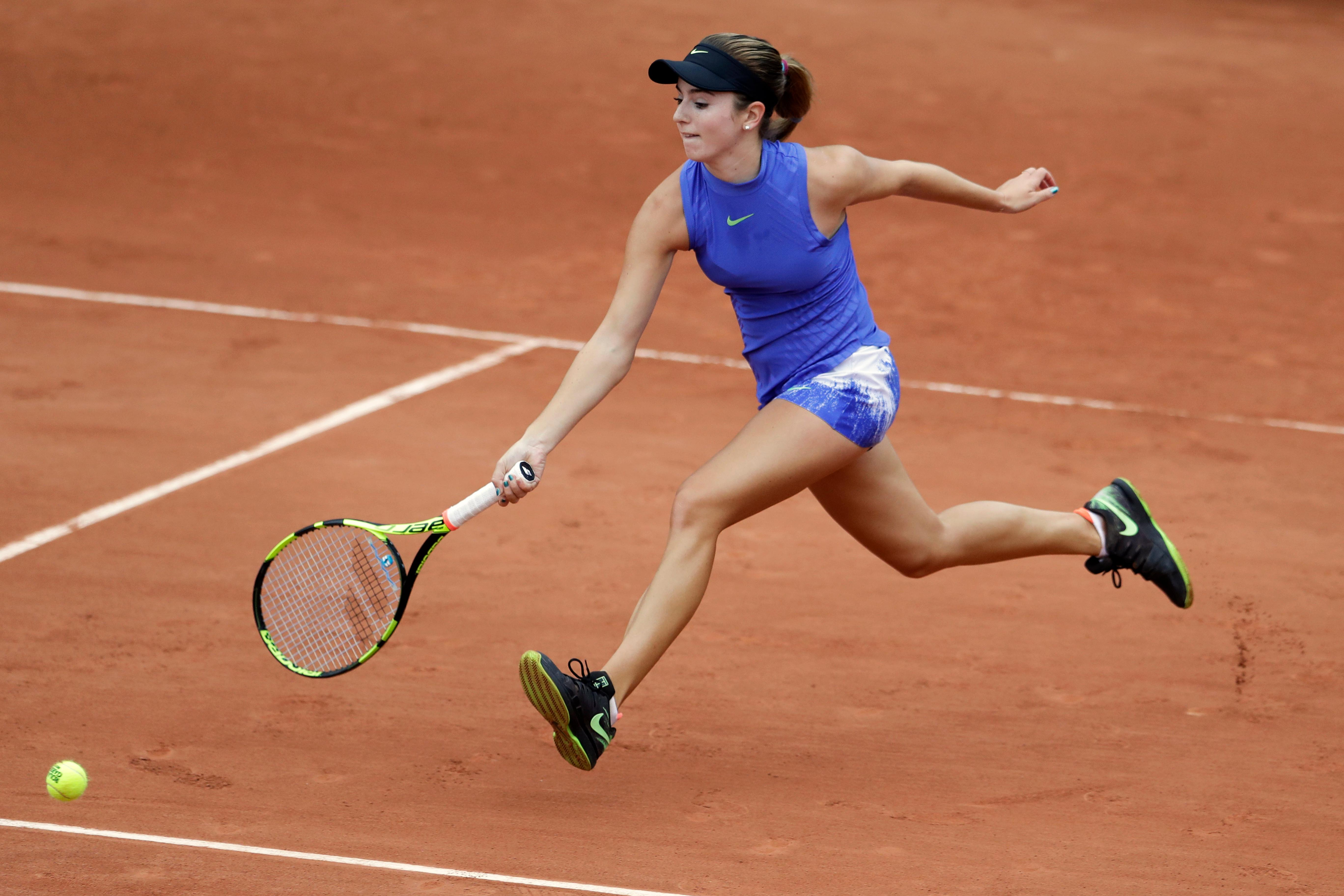 Catherine Bellis of the U.S. plays a shot against Denmark's Caroline Wozniacki during their third round match of the French Open tennis tournament at the Roland Garros stadium, in Paris, France. Saturday, June 3, 2017. (AP Photo/Petr David Josek)