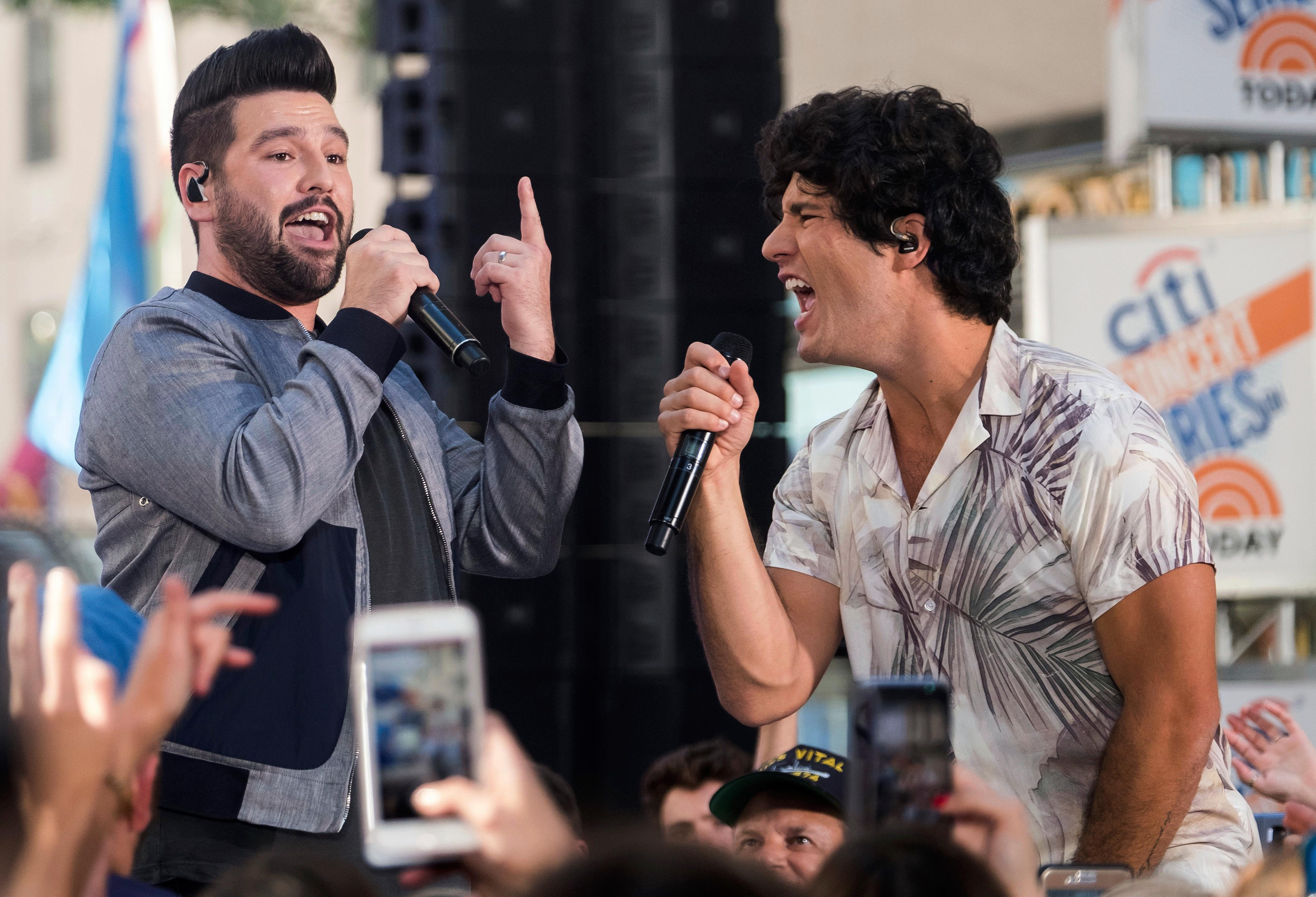 "FILE - In this June 25, 2018, file photo, Shay Mooney, left, and Dan Smyers from the band Dan + Shay perform on NBC's ""Today"" show at Rockefeller Plaza in New York. Chris Stapleton tops the list of finalists with five nominations for the 52nd annual Country Music Association Awards. Dan + Shay received three nominations. (Photo by Charles Sykes/Invision/AP, File)"