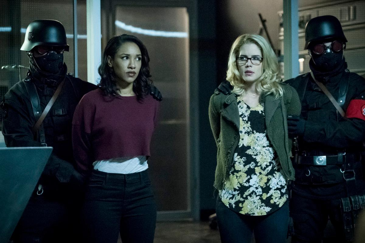"The Flash -- ""Crisis on Earth -- X, Part 3 -- Image Number: FLA408a_0048b.jpg -- Pictured (L-R): Candice Patton as Iris West and Emily Bett Rickards as Felicity Smoak -- Photo: Katie Yu/The CW -- �© 2017 The CW Network, LLC. All rights reserved."