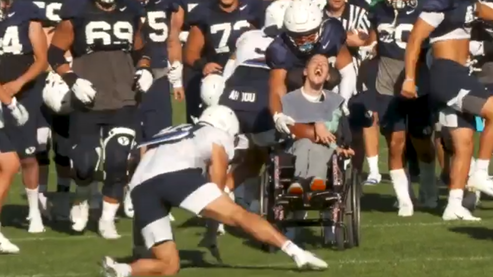 The look on this disabled man's face is priceless after touchdown with BYU football team byu athletics (7).PNG