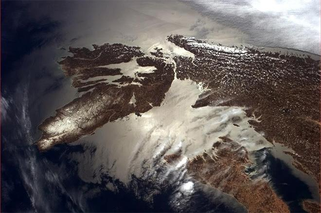 The highlands of Cape Breton still wear the winter's snow, sun highlighting the connecting waters.  (Photo & Caption: Col. Chris Hadfield, NASA)