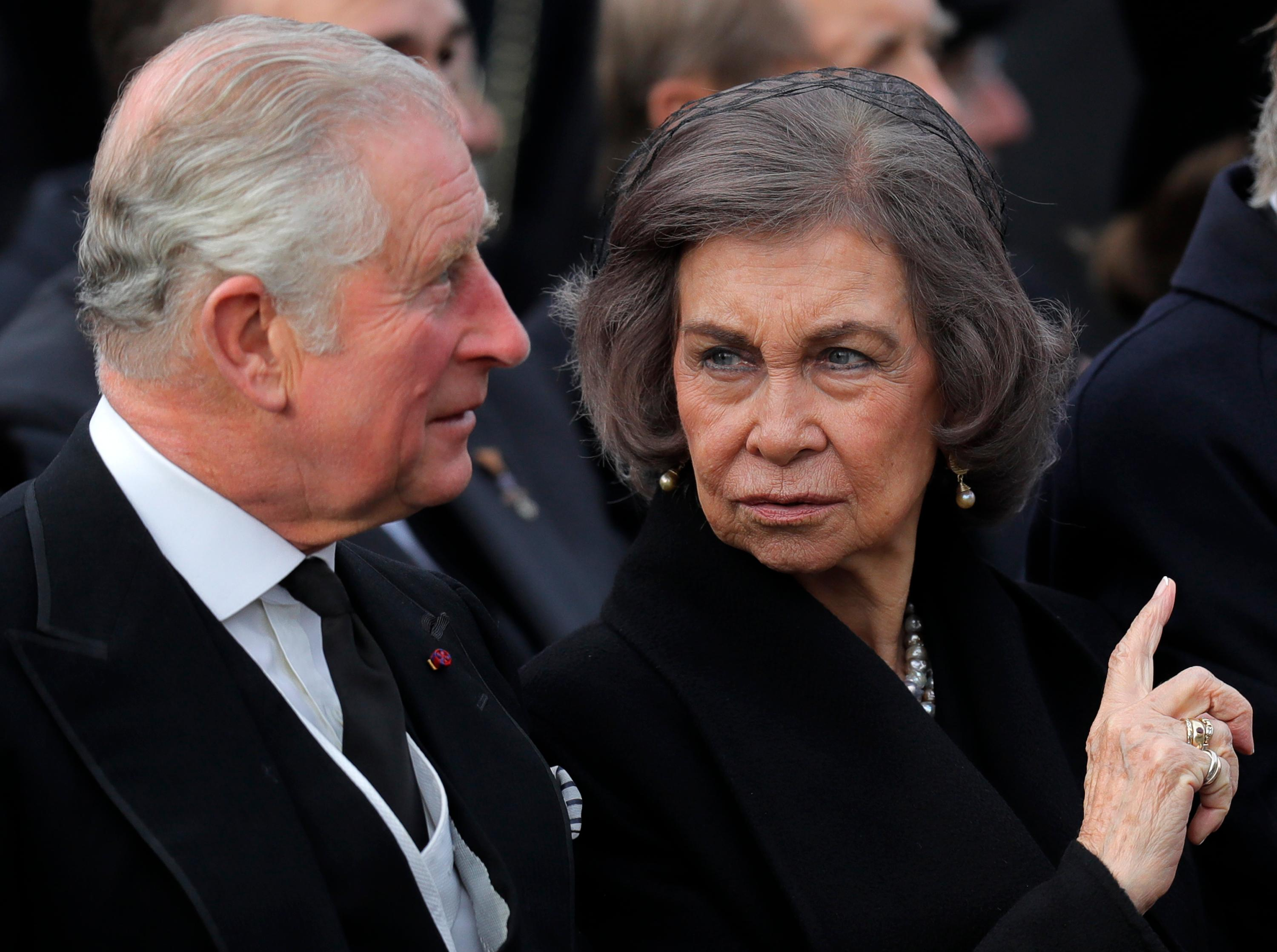 Prince Charles of Britain, left, speaks with former Spanish Queen Sofia during the funeral ceremony in tribute to late Romanian King Michael in Bucharest, Romania, Saturday, Dec.16, 2017. Thousands waited in line to pay their respects to Former King Michael, who ruled Romania during WWII, and died on Dec. 5, 2017, aged 96, in Switzerland. (AP Photo/Vadim Ghirda)