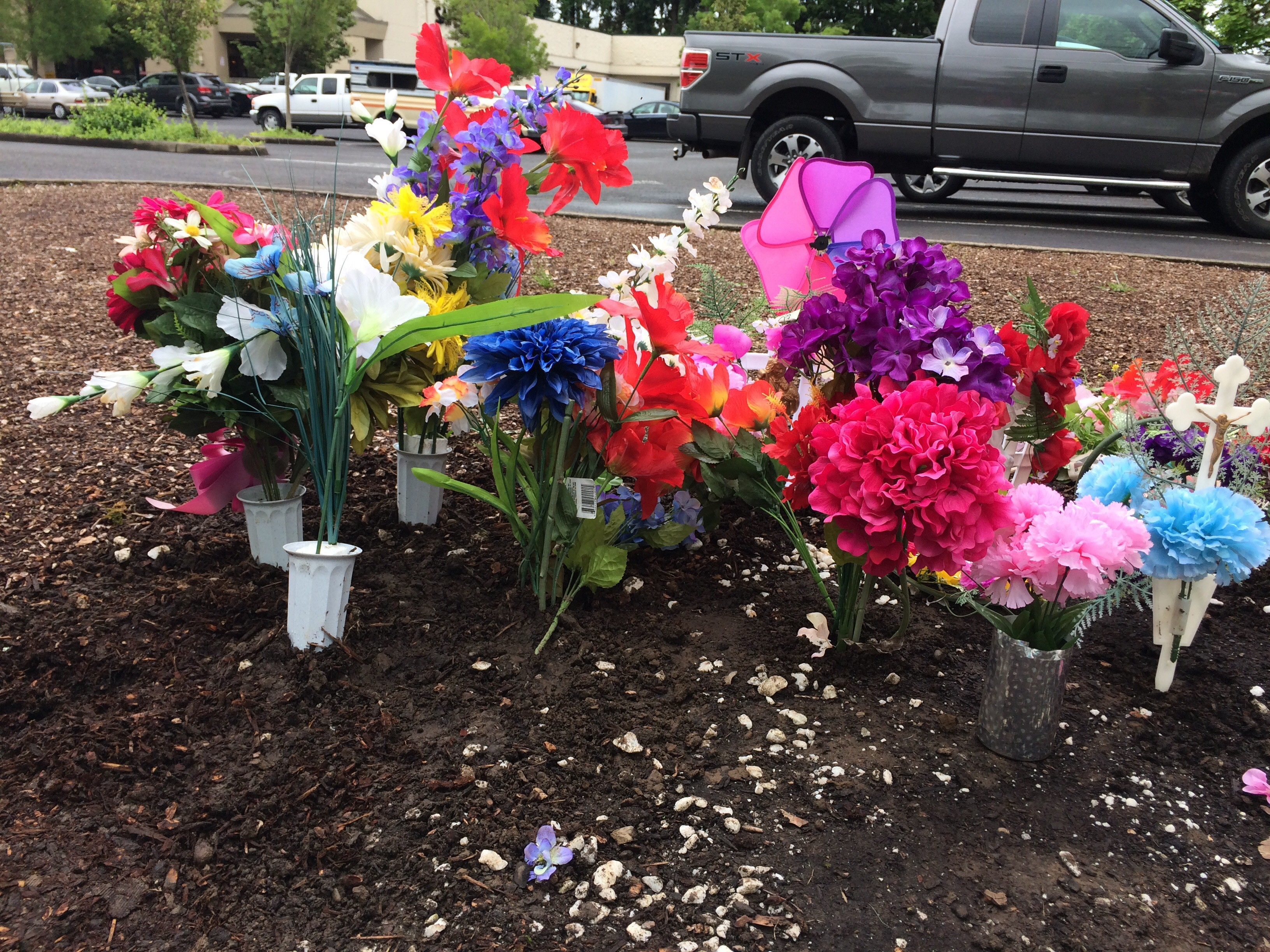 An unknown man planted flowers at the site on Thursday. (SBG)