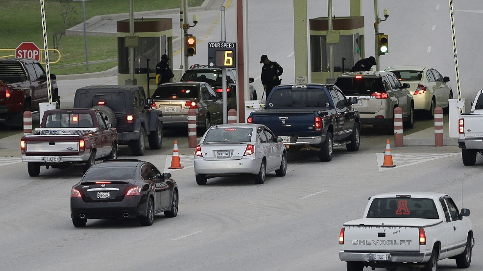 Security check vehicles as they enter Fort Hood's main gate, Thursday, April 3, 2014, in Fort Hood, Texas. A soldier opened fire Wednesday on fellow service members at the Fort Hood military base, killing three people and wounding 16 before committing suicide. (AP Photo/Eric Gay)