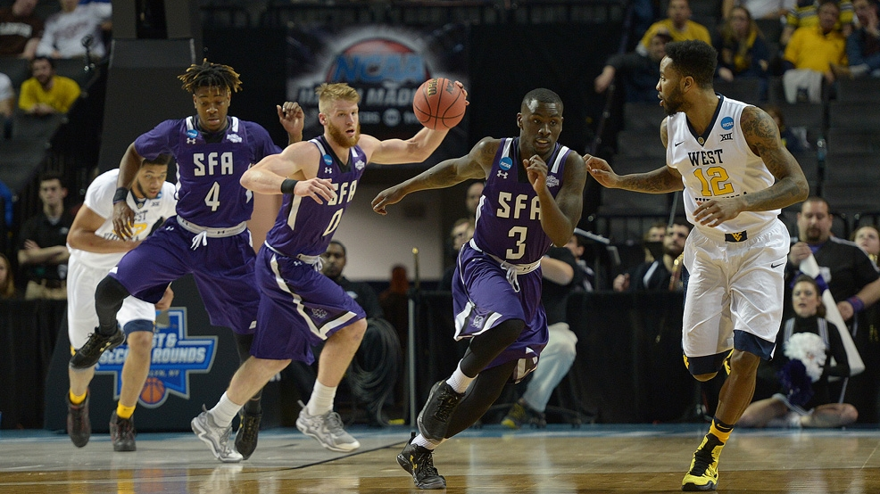 Stephen F. Austin's Thomas Walkup (0) in action against West Virginia. (Courtesy Hardy Meredith/Stephen F. Austin)