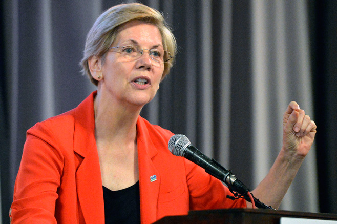 Democratic U.S. Sen. Elizabeth Warren, of Massachusetts speaks to a group of supporters at a rally in support of Kentucky democratic candidate Alison Lundergan Grimes, Sunday, June 29, 2014 at the University of Louisville in Louisville, Ky. (AP Photo/Timothy D. Easley)