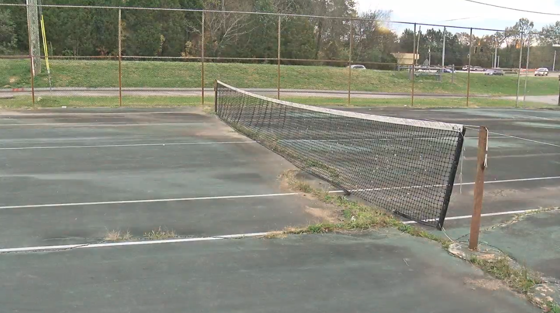 The Hixson High School Tennis Court shows crack in the concrete. Hamilton County schools plans to fix this and the school track as part of the 100-million dollar spending plan. (IMAGE: WTVC)