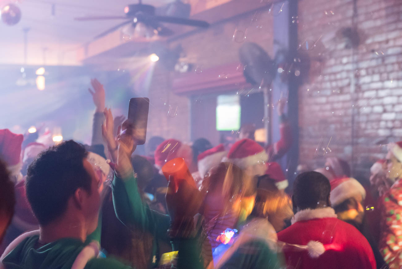 The 10th Annual Cincinnati Santacon was held throughout Downtown Cincinnati as well as OTR. Featured bars had tailored made drink specials and menu items. / Image: Mike Menke