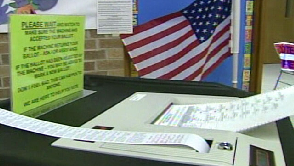 File photo of a ballot entering a counting machine.