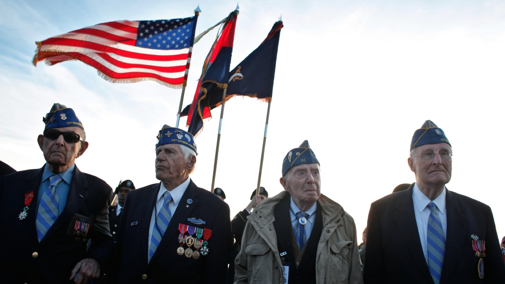 From left, World War II veterans of the U.S. 29th Infantry Division, Hal Baumgarten, 90 from Pennsylvania, Steve Melnikoff, 94, from Maryland, Don McCarthy, 90 from Rhode Island, and Morley Piper, 90, from Massachusetts, attend a D-Day commemoration, on Omaha Beach, western France , Friday June 6, 2014. Veterans and Normandy residents are paying tribute to the thousands who gave their lives in the D-Day invasion of Nazi-occupied France 70 years ago. World leaders and dignitaries including President Barack Obama and Queen Elizabeth II will gather to honor the more than 150,000 American, British, Canadian and other Allied D-Day troops who risked and gave their lives to defeat Adolf Hitler's Third Reich. (AP Photo/Thibault Camus)