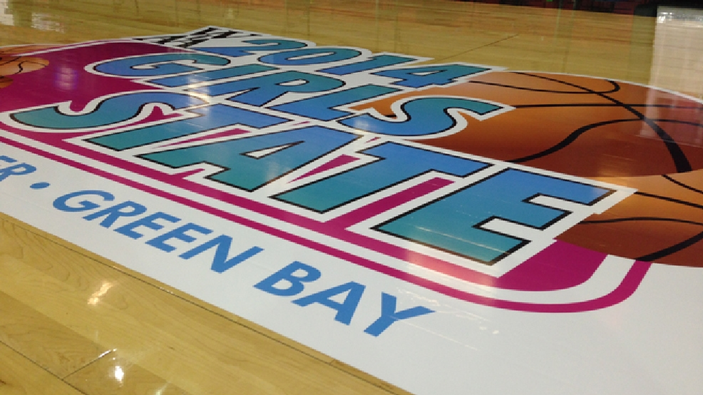 The 2014 WIAA girls state basketball tournament logo is seen on the floor of the Resch Center, March 19, 2014. (WLUK/Laura Smith)