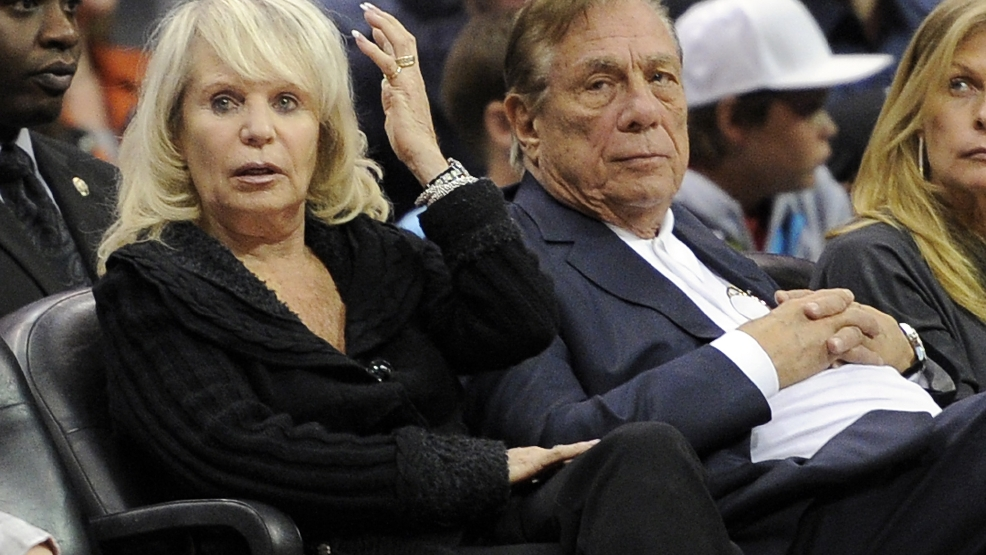 In this Nov. 12, 2010 file photo, Los Angeles Clippers owner Donald T. Sterling, right, sits with his wife Shelly during the Clippers NBA basketball game against the Detroit Pistons in Los Angeles. (AP Photo/Mark J. Terrill, File)
