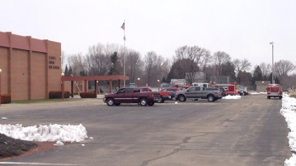 Fire trucks stage at Oconto High School April 16, 2014, after a report of smoke in a hallway. (WLUK/Andrew LaCombe)