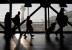 Travelers walk through terminal 3 at O'Hare International airport in Chicago, Sunday, Dec. 1, 2013. (AP Photo/Nam Y. Huh)