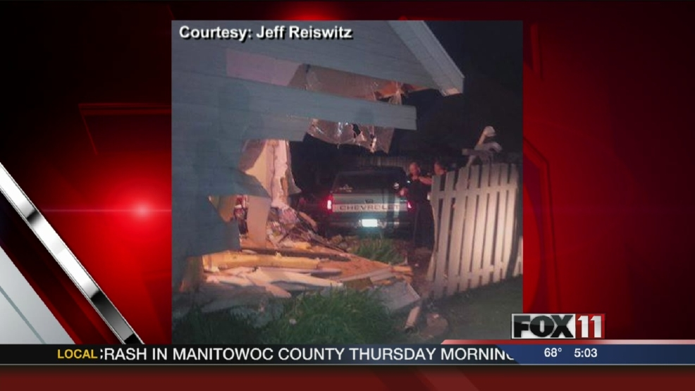 Man runs from scene after slamming truck into Green Bay house
