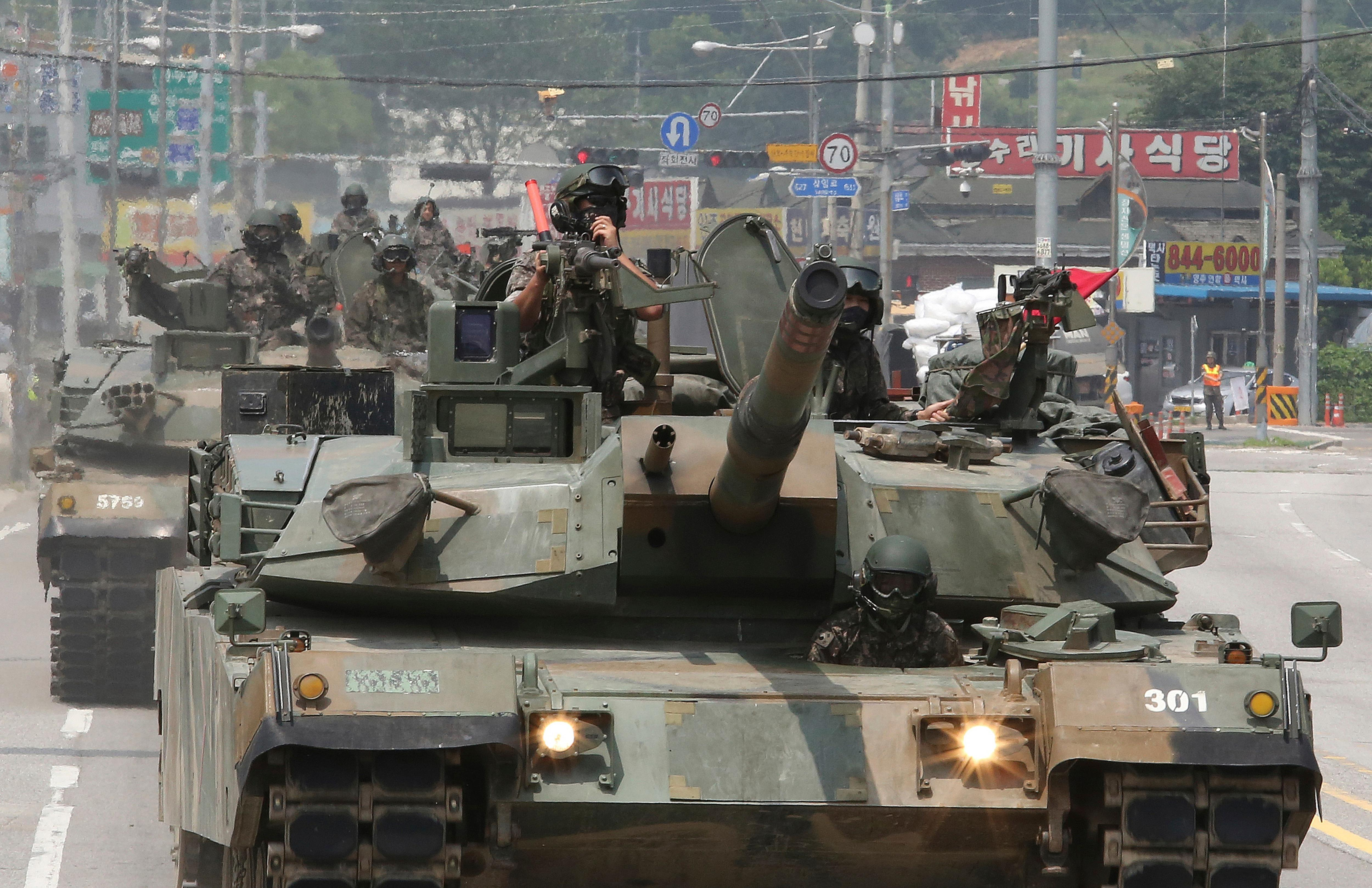 South Korea Army soldiers ride K-1 tanks during the annual exercise in Paju, South Korea, near the border with North Korea, Wednesday, July 5, 2017.  (AP Photo/Ahn Young-joon)