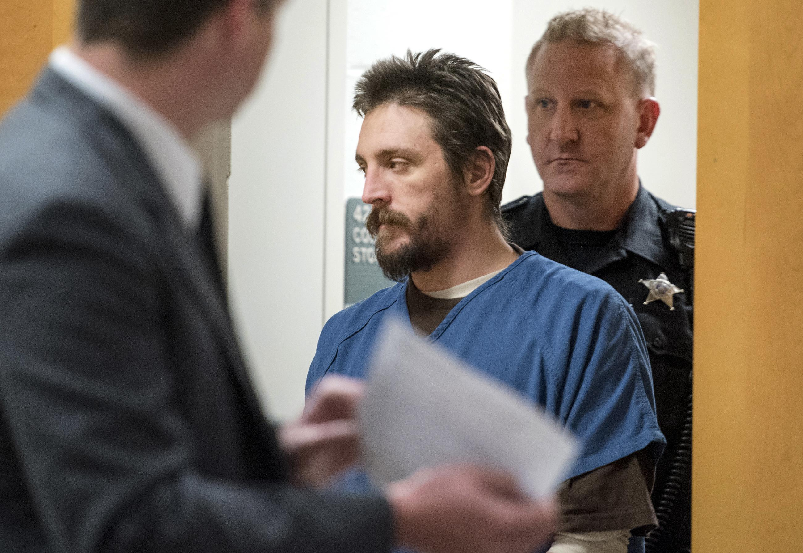 In this Oct. 19, 2017 file photo, Joseph Jakubowski is escorted into a courtroom at the Rock County Courthouse in Janesville. (Angela Major/The Janesville Gazette via AP, File)