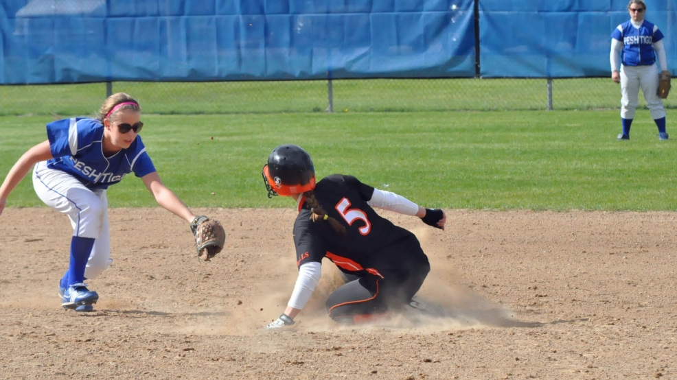 Oconto Falls' McKenna Larsen (5) steals second base against Peshtigo during Thursday's regional game. (Doug Ritchay?WLUK)