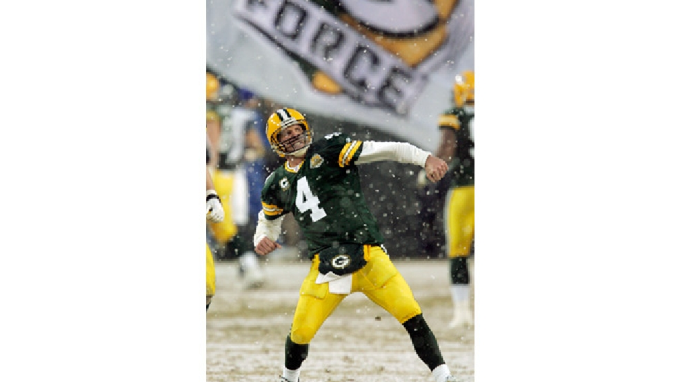Green Bay Packers quarterback Brett Favre reacts to a touchdown during the first half of an NFL divisional playoff game against the Seattle Seahawks Saturday, Jan. 12, 2008, in Green Bay. (AP Photo/Mike Roemer)