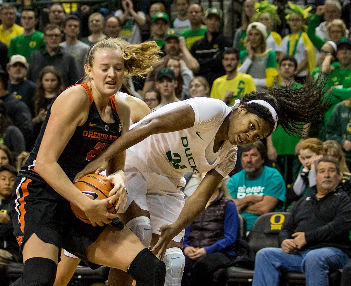 Oregon Ducks Ruthy Hebard (#24) fights for control of the ball. The Oregon Ducks defeated the Oregon State Beavers 75-63 on Sunday afternoon in front of a crowd of 7,249 at Matthew Knight Arena. The Ducks and Beavers split the two game Civil War with the Beavers defeating the Ducks on Friday night in Corvallis. The Ducks had four players in double digits: Satou Sabally with 21 points, Maite Cazorla with 16, Sabrina Ionescu with 15, and Mallory McGwire with 14. The Ducks shot 48.4% from the floor compared to the Beavers 37.3%. The Ducks are now 7-1 in conference play. Photo by Rhianna Gelhart, Oregon News Lab
