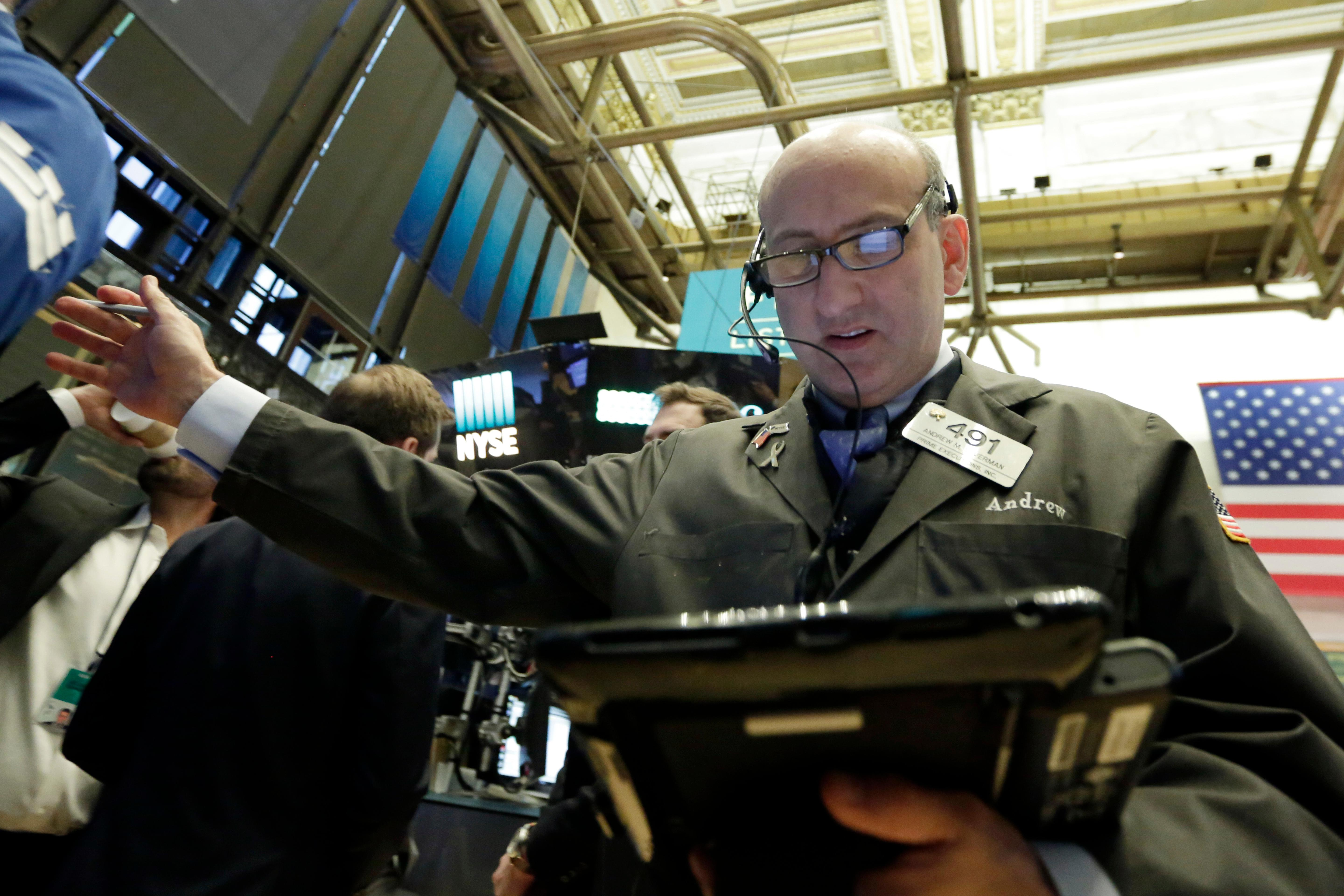 Trader Andrew Silverman works on the floor of the New York Stock Exchange, Monday, Feb. 5, 2018. Stock markets around the world took another pummeling Monday as investors continued to fret over rising U.S. bond yields. (AP Photo/Richard Drew)