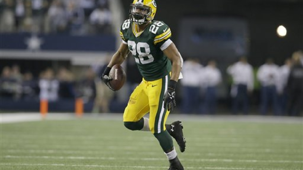 Green Bay Packers safety Sean Richardson (28) runs during the second half of an NFL football game against the Dallas Cowboys Sunday, Dec. 15, 2013, in Arlington, Texas. (AP Photo/Tony Gutierrez)