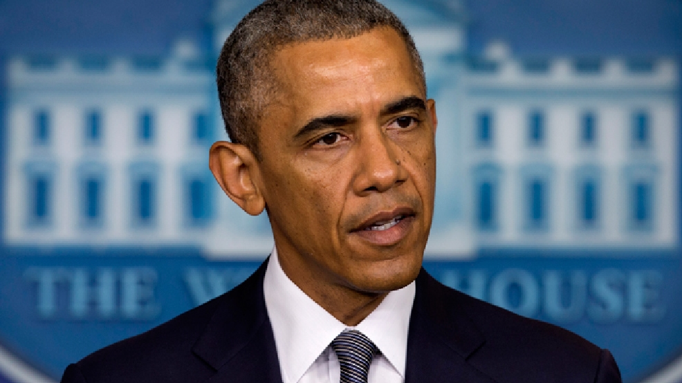 President Barack Obama speaks about the situation in Ukraine, Friday, July 18, 2014, in the Brady Press Briefing Room of the White House in Washington. Obama called for immediate ceasefire in Ukraine, demands credible investigation of downed plane. (AP Photo/Jacquelyn Martin)
