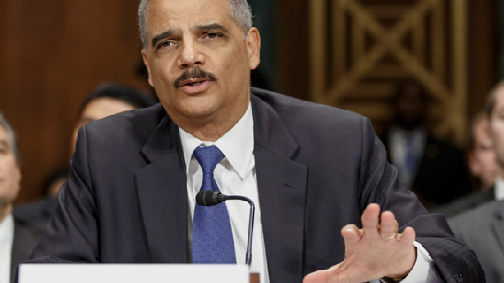 FILE - In this Jan. 29, 2014, file photo, Attorney General Eric Holder testifies on Capitol Hill in Washington. (AP Photo/J. Scott Applewhite, File)