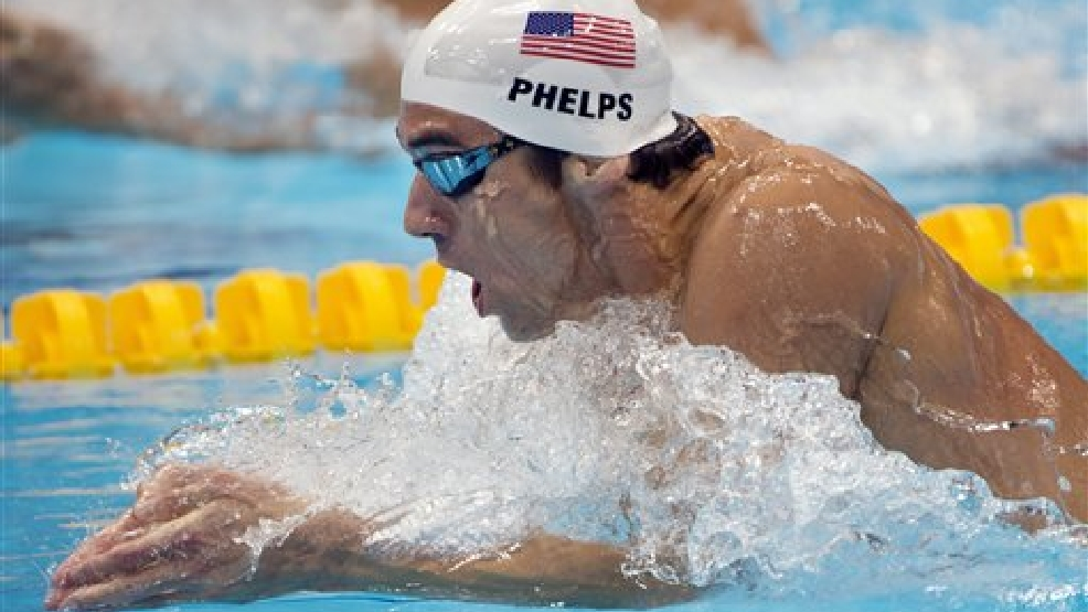 United States' Michael Phelps swims in his men's 200-meter individual medley heat at the Aquatics Centre in the Olympic Park during the 2012 Summer Olympics in London, Wednesday, Aug. 1, 2012.(AP Photo/The Canadian Press, Ryan Remiorz)