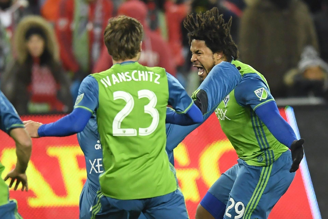 Seattle Sounders defender Roman Torres (29) celebrates his winning goal during penalty kicks in the MLS Cup soccer final against Toronto FC in Toronto, Saturday, Dec. 10, 2016. (Nathan Denette/The Canadian Press via AP)