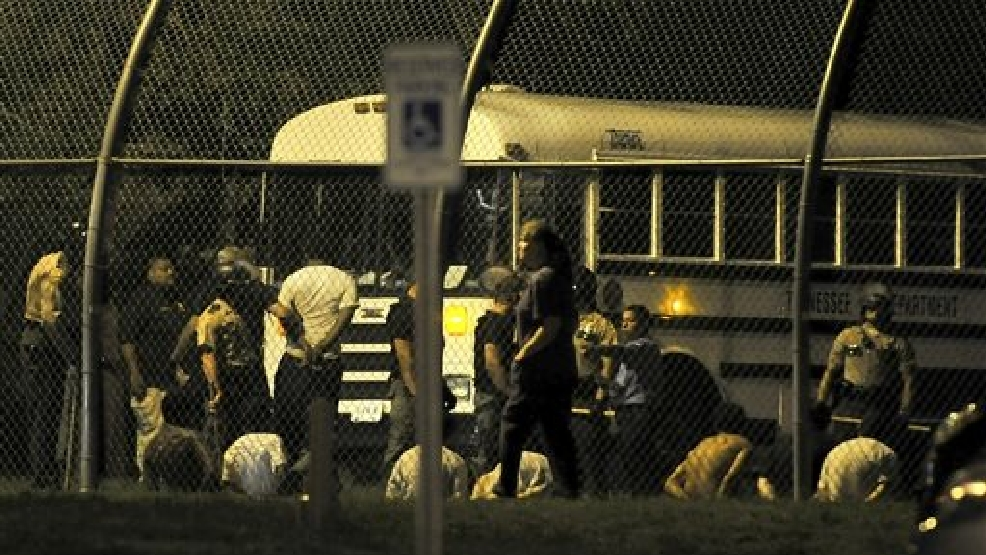 Teenagers are escorted to an awaiting Tennessee Department of Correction bus in custody after a riot at Woodland Hills Youth Development Center in Nashville, Tenn., early Thursday, Sept. 4, 2014. More than two dozen teens created a large disturbance Wednesday night in the yard of a detention center with a long history of violence, escape attempts and sexual-abuse allegations. 32 teens escaped from the facility two days earlier. (AP Photo/The Tennessean, Jae S. Lee)