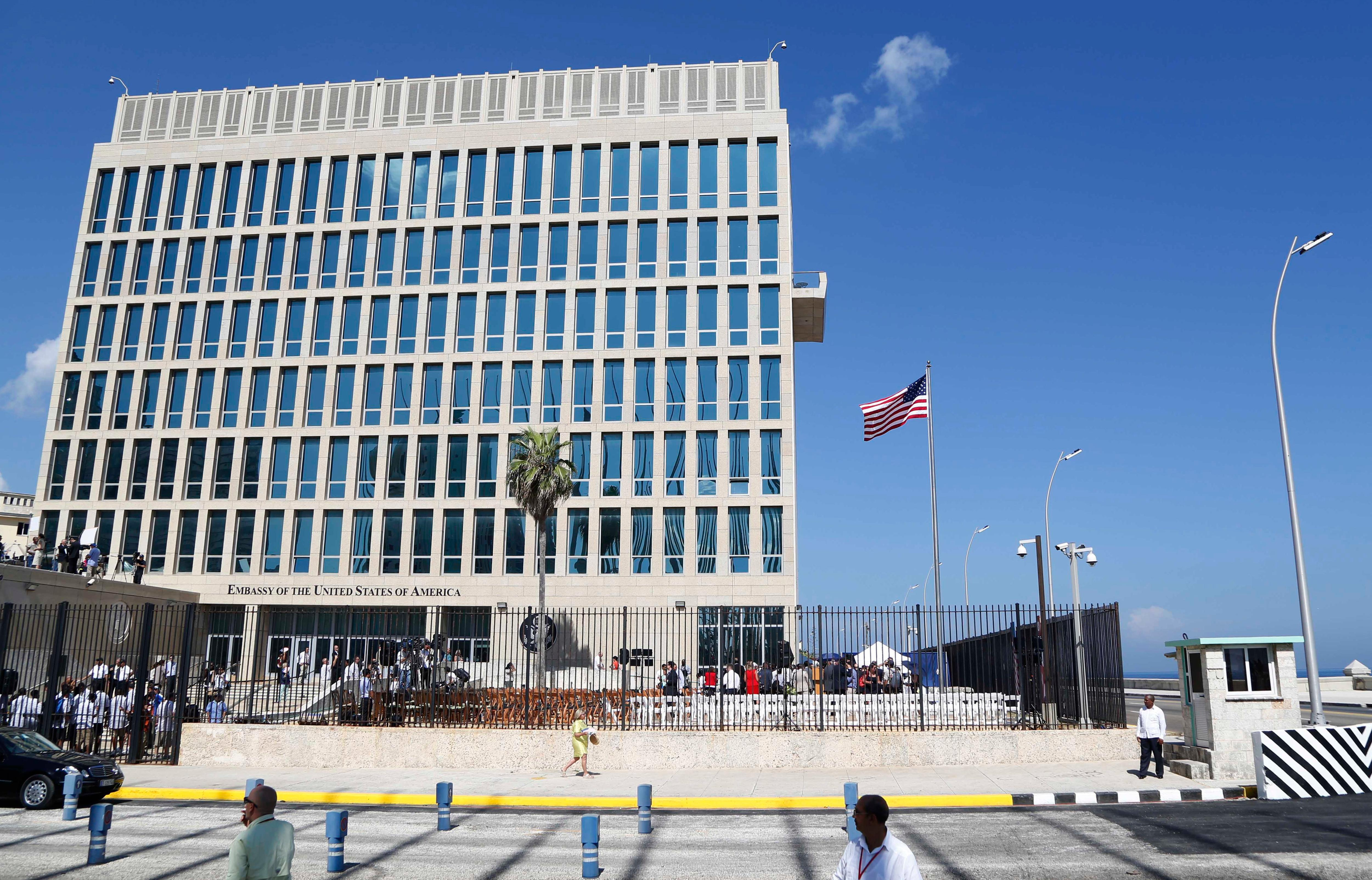 FILE - In this Aug. 14, 2015, file photo, a U.S. flag flies at the U.S. embassy in Havana, Cuba. Senior U.S. officials say the United States is pulling roughly 60 percent of its staff out of Cuba and warning American travelers not to visit. (AP Photo/Desmond Boylan, File)