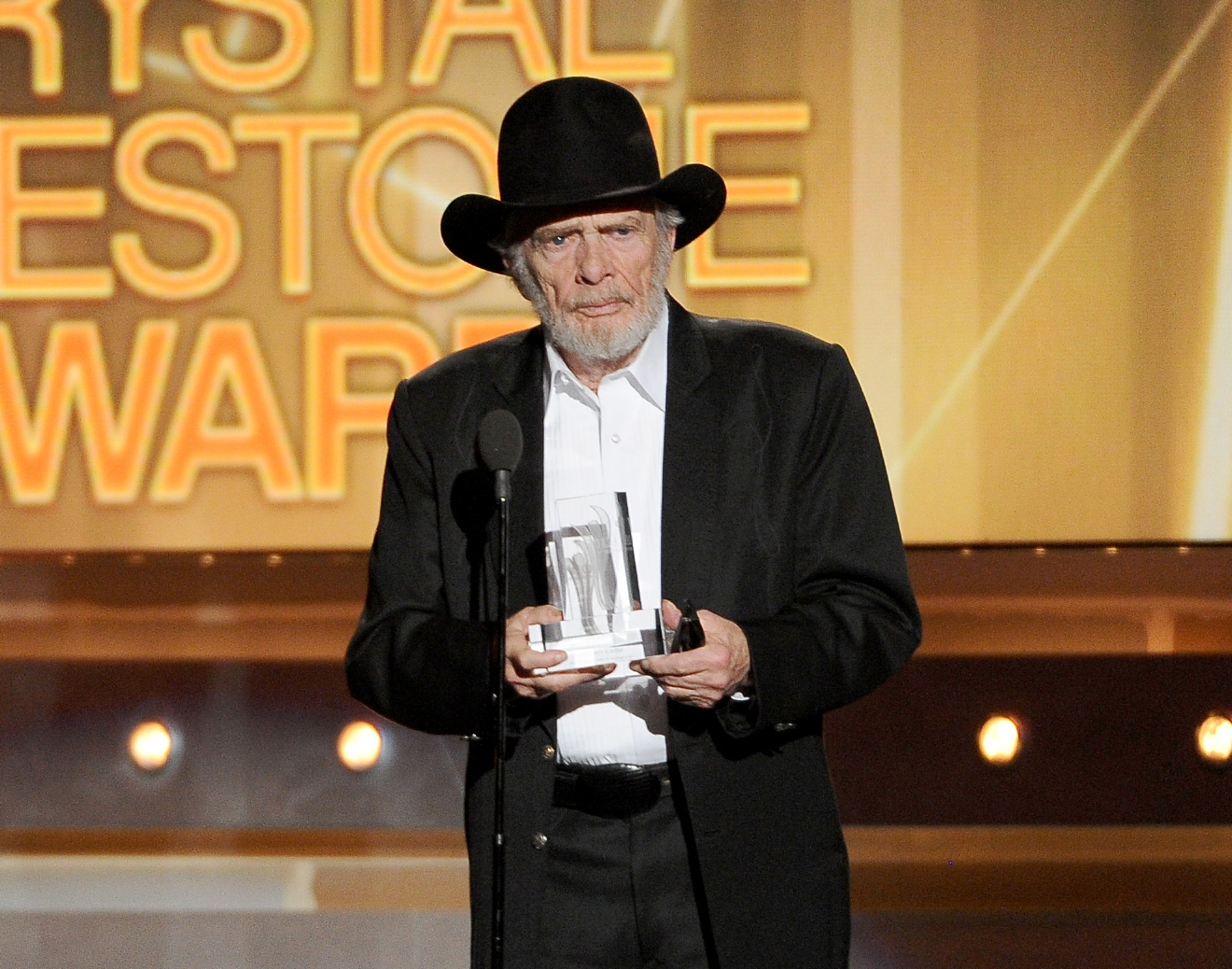 FILE - In this April 6, 2014 file photo, Merle Haggard accepts the crystal milestone award at the 49th annual Academy of Country Music Awards in Las Vegas.Haggard died of pneumonia, Wednesday, April 6, 2016, in Palo Cedro, Calif. He was 79. (Photo by Chris Pizzello/Invision/AP, File)