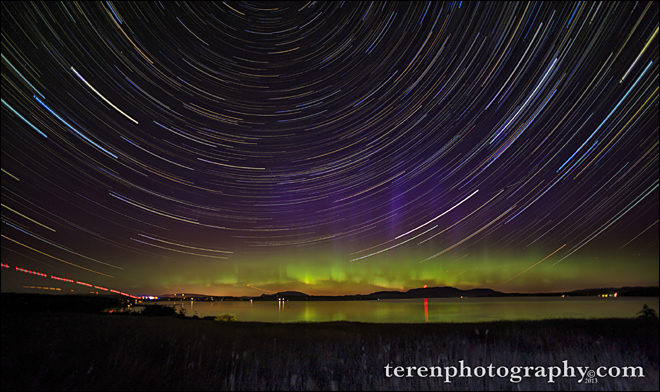 """It's actually 425 photos stacked, showing the Northern Lights over Friday Harbor, Orcas Island, and Griffin Bay, along with star trails!"" -- Photographer Chris Teren"