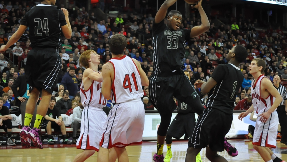 Dominican's Diamond Stone grabs a rebound against Brillion during their Division 4 state semifinal game Thursday. (Doug Ritchay/WLUK)