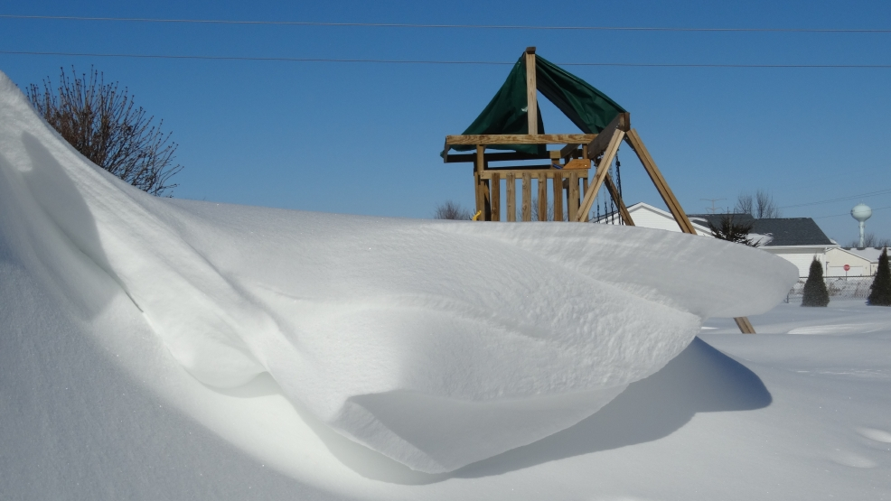 A large snowdrift in a backyard in Darboy, Jan. 27, 2014. (Submitted by Sara Laitinen-Scheel)