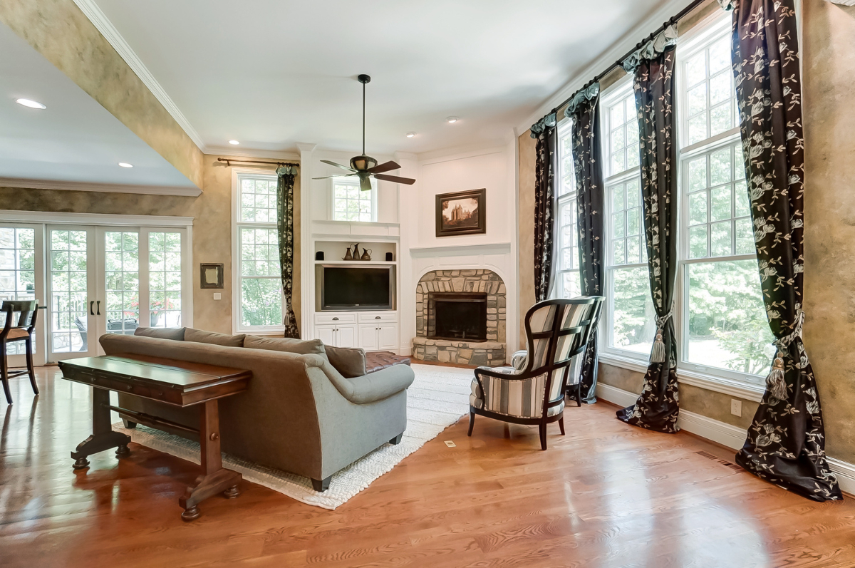 <p>Throughout the home, you'll find cozy fireplaces (the house has three total), gorgeous wood floors, beautiful crown molding, and elegant French doors. / Image courtesy of Wow Video Tours via Michael Franz of Coldwell Banker West Shell-Hyde Park // Published: 9.7.20</p>