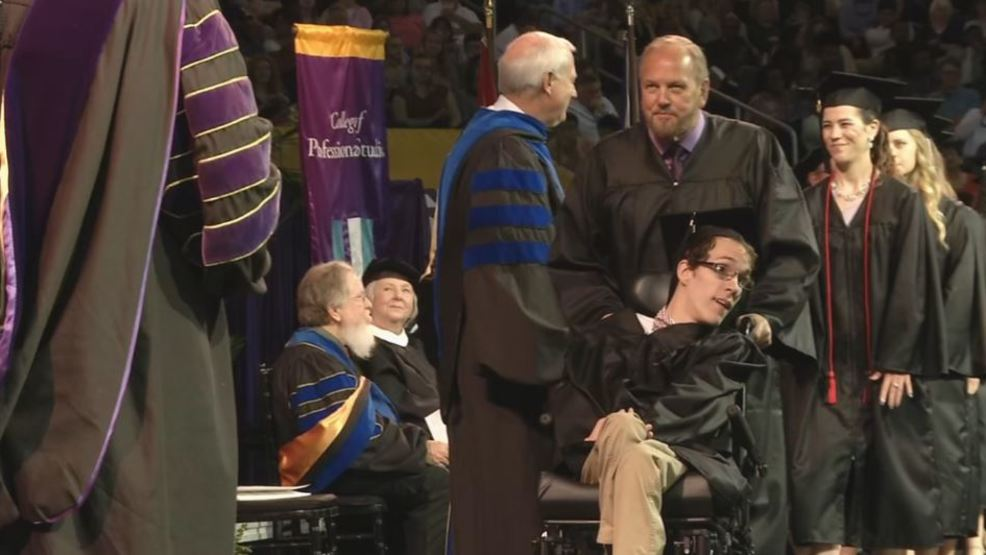 Man with cerebral palsy and his helper earn bachelor degrees from Lipscomb University