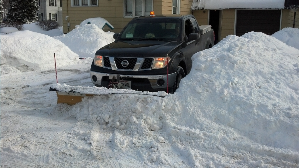 Plow drivers struggle to remove snow piles from Winter Storm Carol. (WLUK/Eric Peterson)
