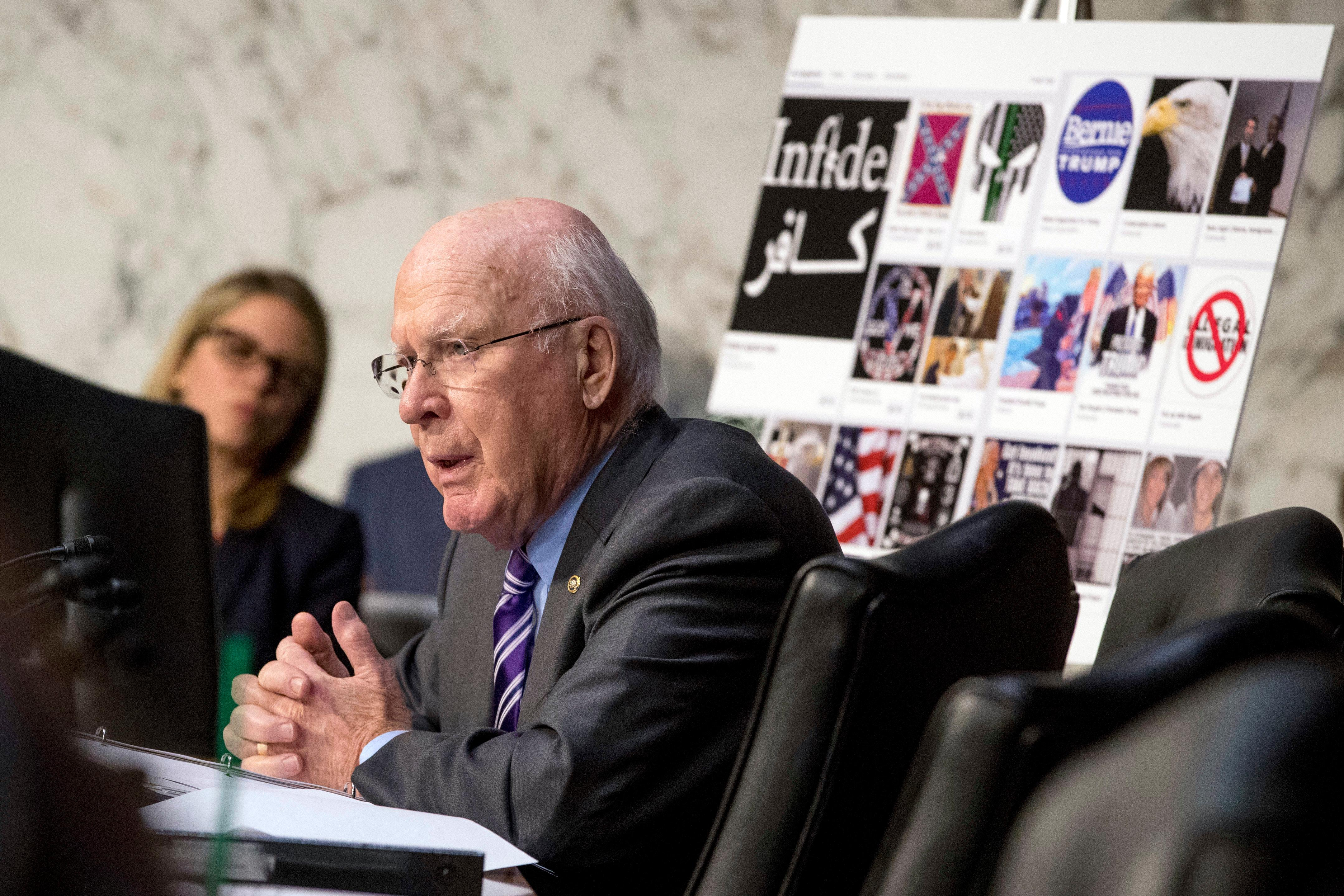 Sen. Patrick Leahy, D-Vt., speaks next to a poster depicting examples of questionable internet ads that he says were found online today as Facebook's General Counsel Colin Stretch, Twitter's Acting General Counsel Sean Edgett, and Google's Law Enforcement and Information Security Director Richard Salgado, testify during a Senate Committee on the Judiciary, Subcommittee on Crime and Terrorism hearing on Capitol Hill in Washington, Tuesday, Oct. 31, 2017. (AP Photo/Andrew Harnik)<p></p>