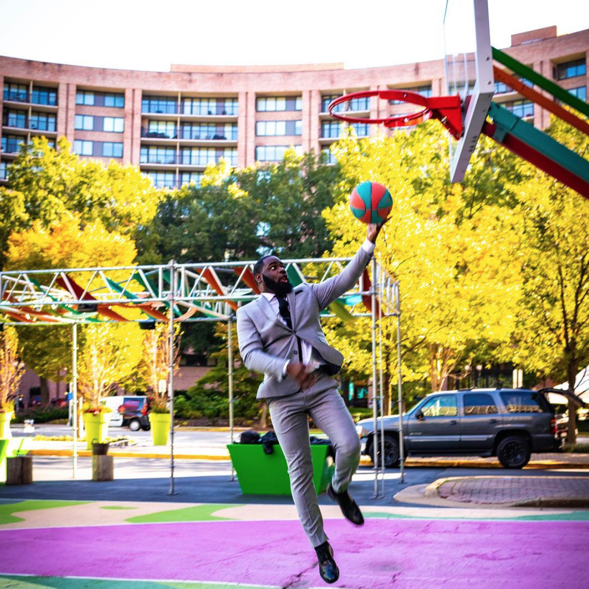 And yes, anyone can play hoops on their colorful basketball courts. (Image via @mrmoorestyle)