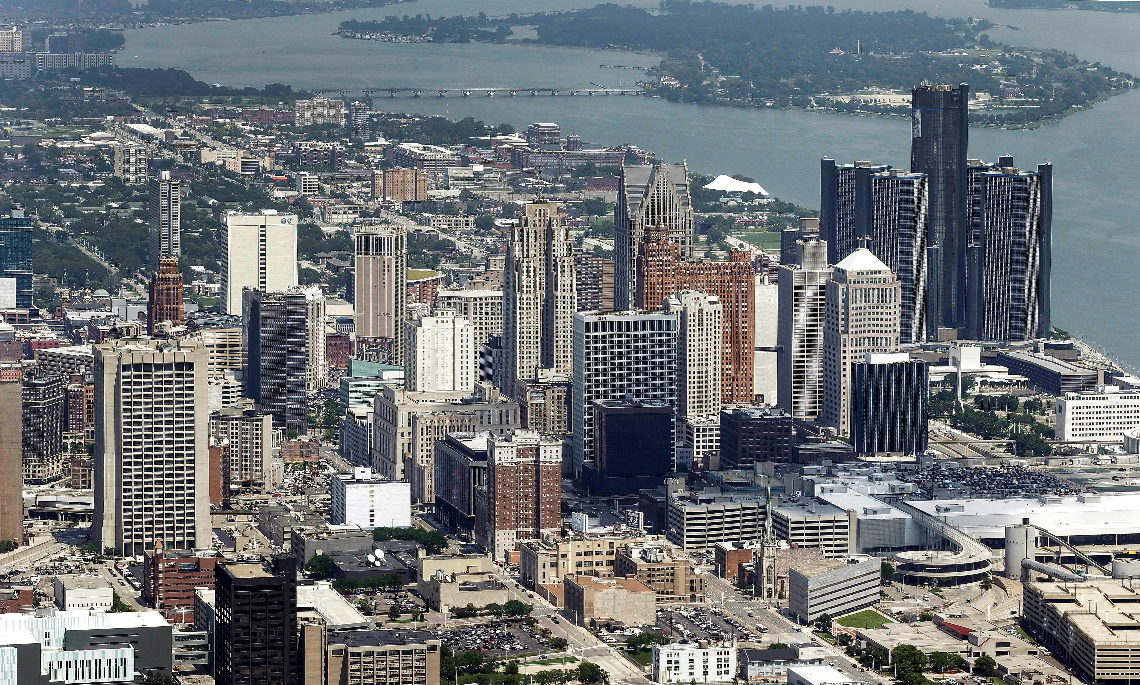 FILE - This July 16, 2013, aerial file photo, shows downtown Detroit. Amazon's final cut of 20 contenders for its second headquarters leaves hundreds of cities disappointed. That includes hopefuls like Detroit, Memphis, Tenn., and Kansas City, Mo. (AP Photo/Paul Sancya, File)