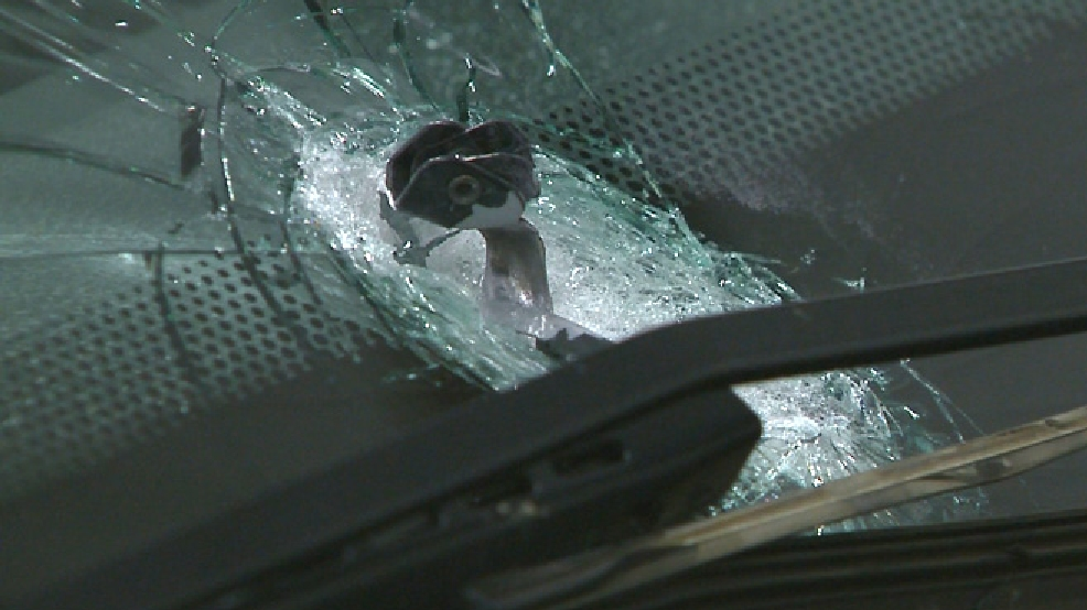 A bullet hole is seen in the windshield of an SUV, July 25, 2014. The SUV was being driven by an Illinois couple when sheriff's deputies say a stranger started shooting at them. (WLUK image)