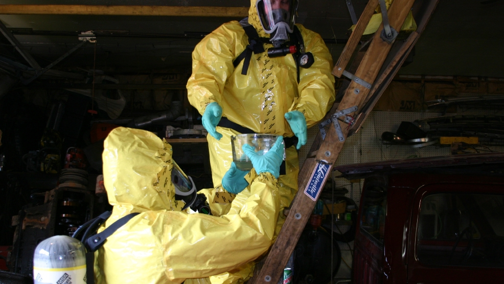 Special agents with the Wisconsin Dept. of Justice dismantle a methamphetamine laboratory in rural Lincoln County. (Courtesy: WI Dept. of Justice)