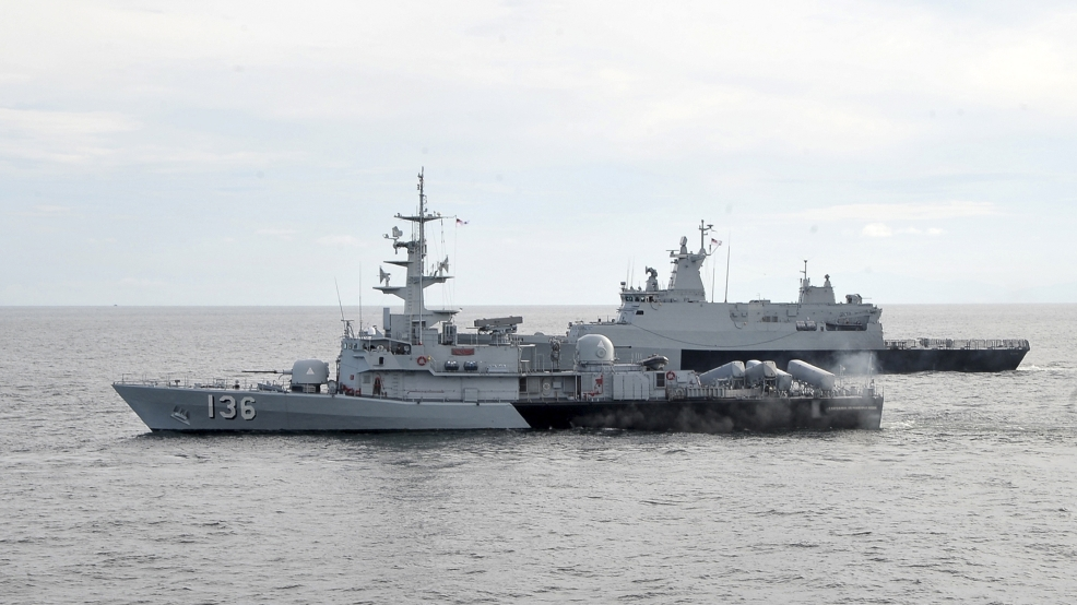 In this photo released by The Royal Malaysian Navy, Royal Malaysian Navy's missile corvette KD Laksamana Muhammad Amin, front, and Royal Malaysian Navy's offshore patrol vessel KD Selangor are seen during a search and rescue operation for the missing Malaysia Airlines plane over the Straits of Malacca, Malaysia, Thursday, March 13, 2014. (AP Photo/The Royal Malaysian Navy)
