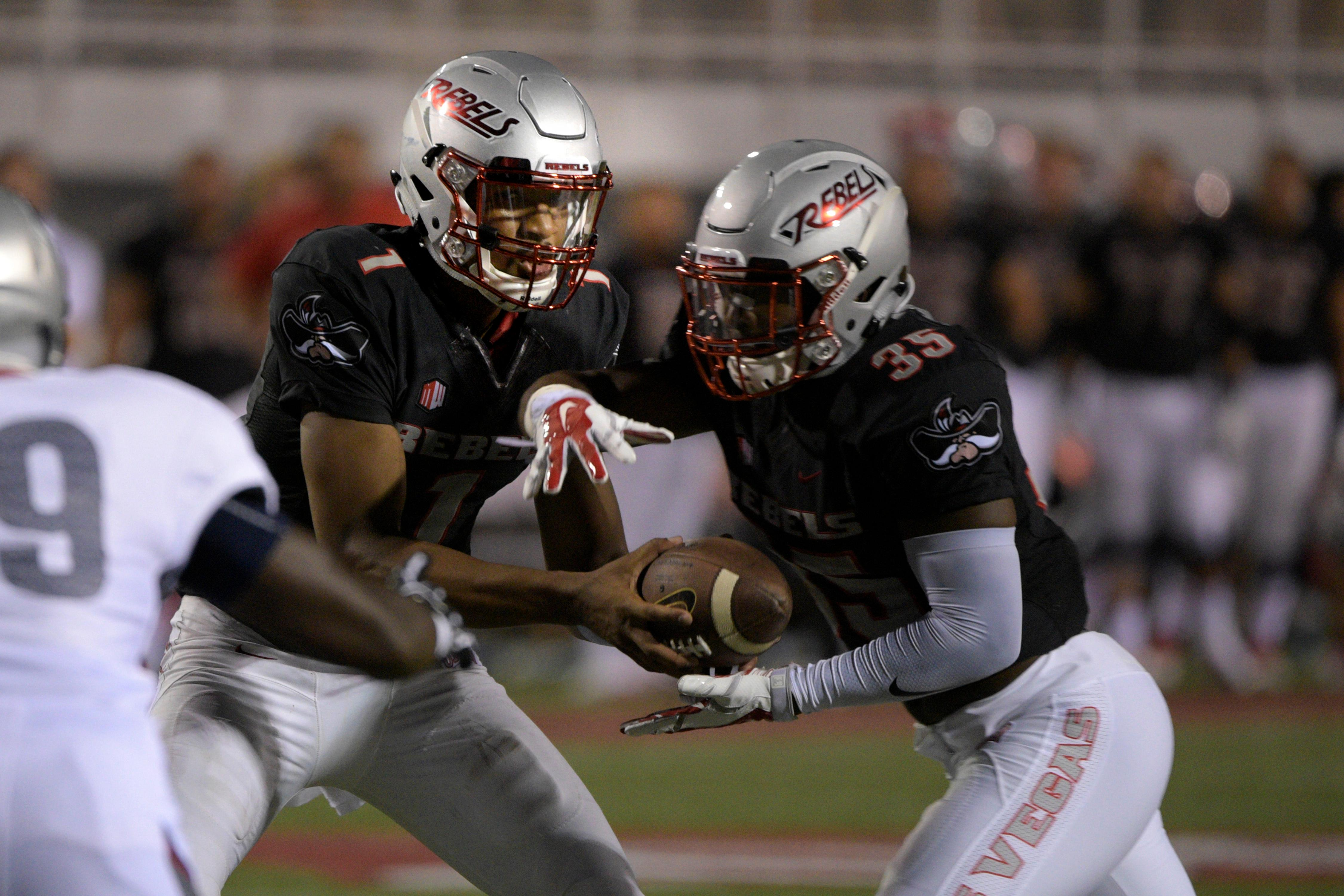 UNLV quarterback Armani Rogers hands off to running back Xaviar Campbell during their game against Howard University Saturday, September 2, 2017, at Sam Boyd Stadium in Las Vegas. Howard defeated UNLV 43-40 to notch what is believed to be the biggest upset in college football history. [Sam Morris/Las Vegas News Bureau]