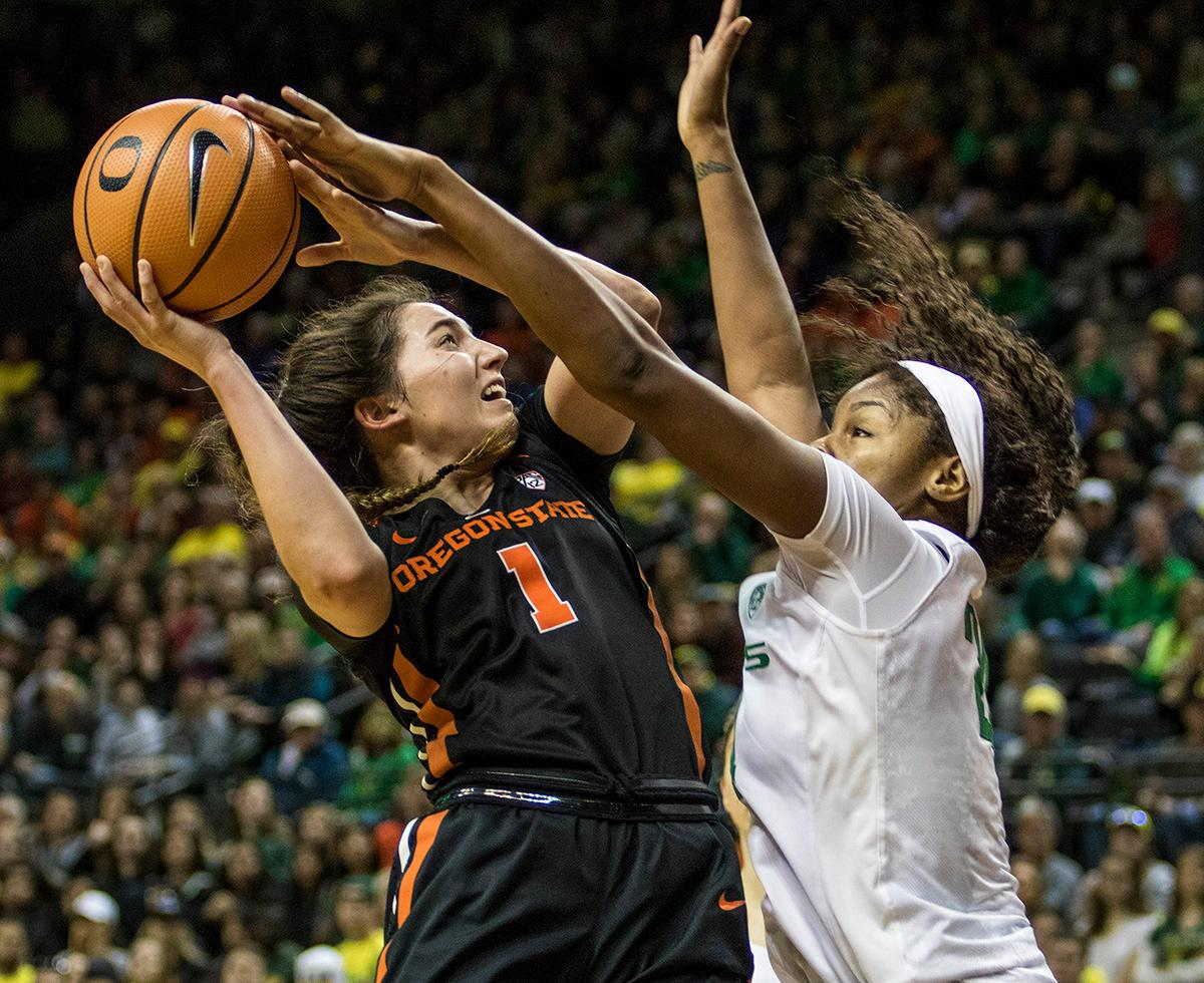 Oregon Ducks Ruthy Hebard (#24) attempts to block the shot of Oregon State Beavers Aleah Goodman (#1). The Oregon Ducks defeated the Oregon State Beavers 75-63 on Sunday afternoon in front of a crowd of 7,249 at Matthew Knight Arena. The Ducks and Beavers split the two game Civil War with the Beavers defeating the Ducks on Friday night in Corvallis. The Ducks had four players in double digits: Satou Sabally with 21 points, Maite Cazorla with 16, Sabrina Ionescu with 15, and Mallory McGwire with 14. The Ducks shot 48.4% from the floor compared to the Beavers 37.3%. The Ducks are now 7-1 in conference play. Photo by Rhianna Gelhart, Oregon News Lab
