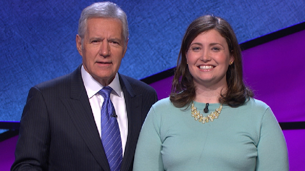 "In this January 2014 photo provided by Jeopardy Productions, Inc., shows Alex Trebek, host of the TV show ""Jeopardy!,"" poses with contestant Julia Collins, 31, of Kenilworth, Ill., during the taping of her shows on stage at JEOPARDY!, Sony Pictures Studios, Culver City, Calif. (AP Photo/Courtesy of Jeopardy Productions, Inc.)"