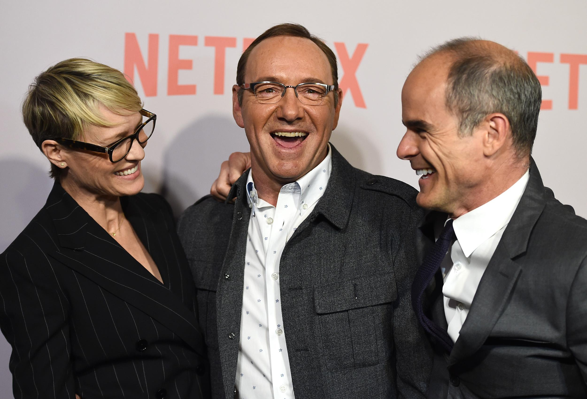 "Robin Wright, from left, Kevin Spacey and Michael Kelly arrive at the Q&A Screening of ""The House Of Cards"" at the Samuel Goldwyn Theater on Monday, April 27, 2015, in Beverly Hills, Calif. (Photo by Jordan Strauss/Invision/AP)"